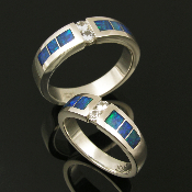 Matching handmade his and hers sterling silver wedding ring set inlaid with Australian opal accented by white sapphires. Beautiful inlaid blue-green Australian opal surrounds two round brilliant cut white sapphires in each of these unique bands.