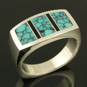 Unique handmade man's sterling silver ring inlaid with spiderweb turquoise and black onyx by jewelry artisan Mark Hileman. The turquoise is a beautiful sky blue with black webbing.