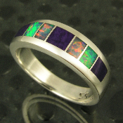 Stunning sterling silver woman's band inlaid with sugilite and Australian opal.
