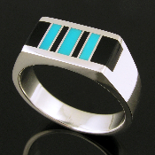 Handmade man's sterling silver ring inlaid with black onyx and turquoise. The ring measures 8.6mm wide and is a size 10. It is available in other sizes and stone colors by special order.