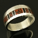Sterling silver man's wedding band inlaid with dinosaur bone and black onyx. Ring style #M202.