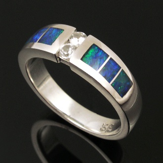 Matching handmade hers and hers sterling silver wedding ring set inlaid with Australian opal accented by white sapphires. Beautiful inlaid blue-green Australian opal surrounds two round brilliant cut white sapphires in each of these unique bands.