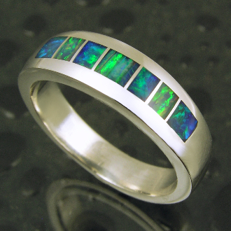 Handmade sterling silver band inlaid with Australian crystal opal by jewelry artisan Mark Hileman. Alternating dark blue and blue-green Australian opal make this a very unique looking ring.
