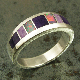 Handmade sterling silver woman's ring inlaid with sugilite and Australian opal. Band is inlaid with 3 pieces of dark purple sugilite and 2 pieces of lavender sugilite. The Australian opal fires multiple colors.
