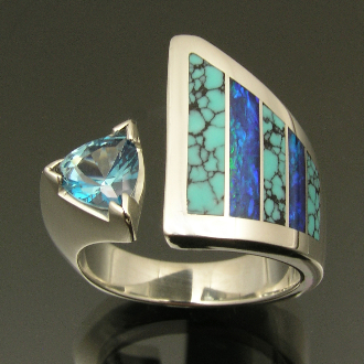Unique handmade woman's sterling silver blue topaz ring inlaid with Australian opal and spiderweb turquoise.