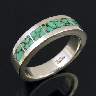 Man's handmade sterling silver ring inlaid with spider web turquoise. This handcrafted ring band showcases some of the best spider web turquoise inlay the southwest has to offer.