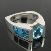Unique spiderweb turquoise inlay ring with Australian opal accents in sterling silver. The turquoise in this spectacular ring is blue with a tight black spiderweb pattern. The blue opal inlay is a nice accent to the color of the inlaid turquoise.