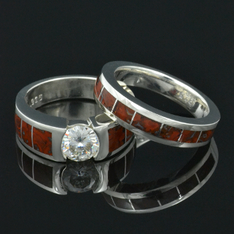 Dinosaur bone wedding and engagement ring bridal set in sterling silver with a sparkling white moissanite in the center.