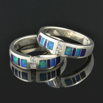 Matching handmade his and hers sterling silver wedding ring set inlaid with Australian opal and purple sugilite accented by white sapphires.