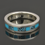 Spiderweb turquoise and turquoise inlay ring in sterling silver. This handcrafted ring band showcases some of the best spiderweb turquoise inlay the southwest has to offer.