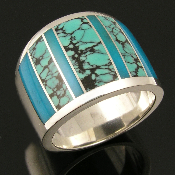 Sterling silver ring inlaid with spiderweb turquoise and gem silica by Mark Hileman. Beautiful translucent blue gem silica combined with awesome black matrix spiderweb turquoise make a very striking ring.