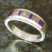 Very unique handmade sterling silver ring inlaid with sugilite and Australian opal. The 3 pieces of inlaid Australian opal are an incredible neon rainbow of colors.