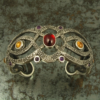 Sterling silver cuff bracelet with amethyst, garnet and citrine cabochons.