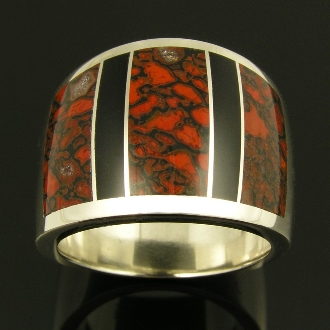 Wide sterling silver ring band inlaid with rare red dinosaur bone and black onyx.