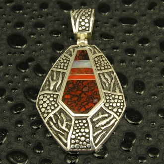 Sterling silver pendant inlaid with two types of dinosaur bone, red Australian opal and red coral. Dinosaur bone is red celled with black matrix and red-brown with a gray matrix.