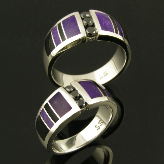 Unique his and hers sterling silver black diamond wedding set inlaid with sugilite and black onyx. Matching handmade bands feature 3 channel set round black diamonds flanked by alternating black onyx and purple sugilite inlay.