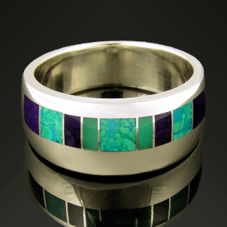 Unique man's sterling silver ring band inlaid with chrysocolla, sugilite and chrysoprase. There are 4 pieces of inlaid purple sugilite and 2 pieces of green chrysoprase inlay.