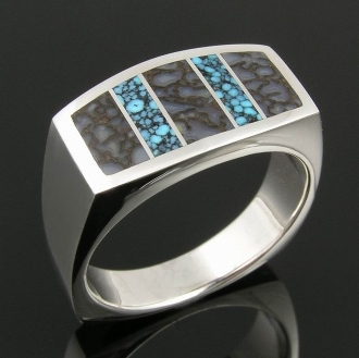 Dinosaur bone and spiderweb turquoise in a man's sterling silver ring! This ring features a unique combination of inlaid gray dinosaur bone with blue spiderweb turquoise.