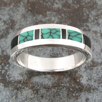 Man's handmade sterling silver ring inlaid with spiderweb turquoise and black onyx. This handcrafted ring band would make a great turquoise wedding ring.