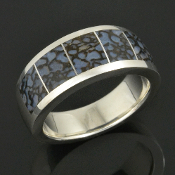 Blue dinosaur bone ring in sterling silver handmade by Hileman Silver Jewelry. The 10mm ring band really shows the color and pattern of the dinosaur bone inlay.