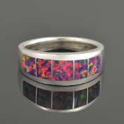 Woman's lab created opal ring handcrafted in sterling silver by Hileman Silver Jewelry.