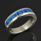 Man's lab opal wedding band with blue-green lab opal inlaid in sterling silver.