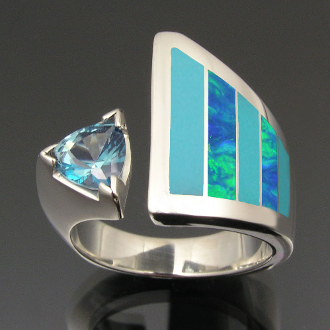 Unique handmade woman's sterling silver turquoise ring with lab opal and a sparking blue topaz.